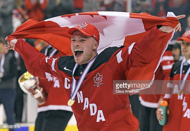 Max Domi of Team Canada skates with the flag after defeating Team Russia in the Gold medal game in the 2015 IIHF World Junior Hockey Championship at...
