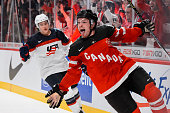 Max Domi of Team Canada sticks out his tongue after scoring on an empty net late in the third period in a preliminary round game at the 2015 IIHF...