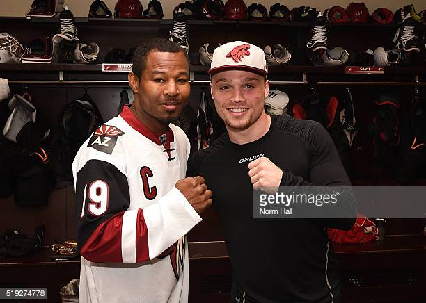 Max Domi of the Arizona Coyotes and professional boxer Sugar Shane Mosley pose for a photo in the locker room following a game against the Washington...