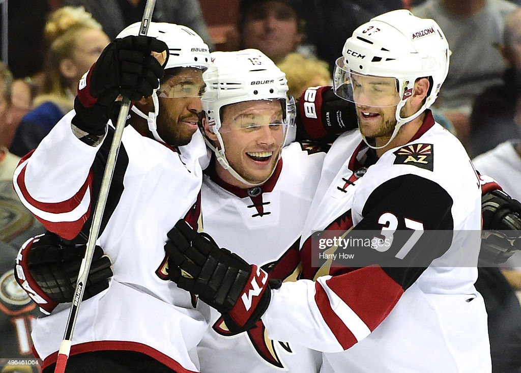 Max Domi of the Arizona Coyotes celebrates his goal second goal of the game with Anthony Duclair and Dustin Jeffrey to tie the game 22 with the...