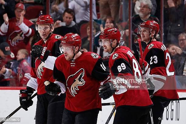 Max Domi of the Arizona Coyotes celebrates with Martin Hanzal Mikkel Boedker and Oliver EkmanLarsson after Domi scored a hat trick goal against the...