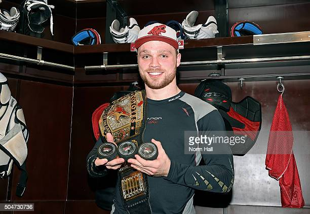 Max Domi of the Arizona Coyotes holds the pucks from his first career NHL hat trick following a 43 overtime win against the Edmonton Oilers at Gila...