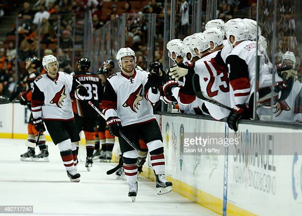 Max Domi of the Arizona Coyotes is congratulated at his bench during the first period after scoring against the Anaheim Ducks during a game at Honda...