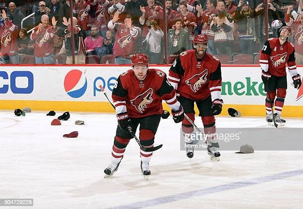 Max Domi of the Arizona Coyotes skates back to the bench with teammate Anthony Duclair after his hat trick against the Edmonton Oilers at Gila River...