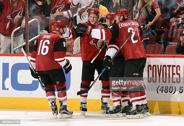 Max Domi of the Arizona Coyotes skates in to join the celebration after a goal against the Nashville Predators by teammate Anthony Duclair during the...
