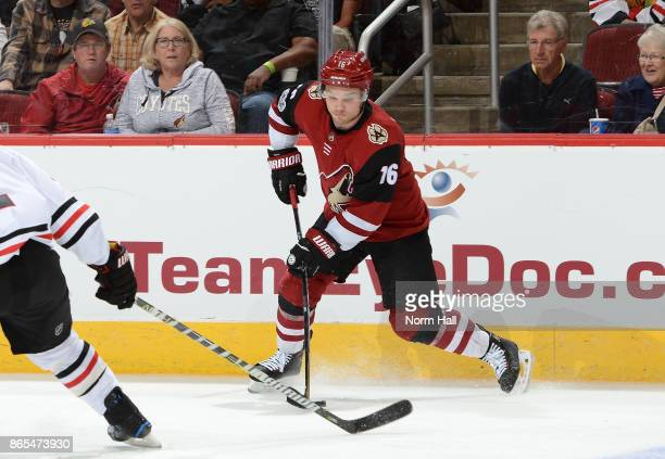 Max Domi of the Arizona Coyotes skates with the puck against the Chicago Blackhawks at Gila River Arena on October 21 2017 in Glendale Arizona