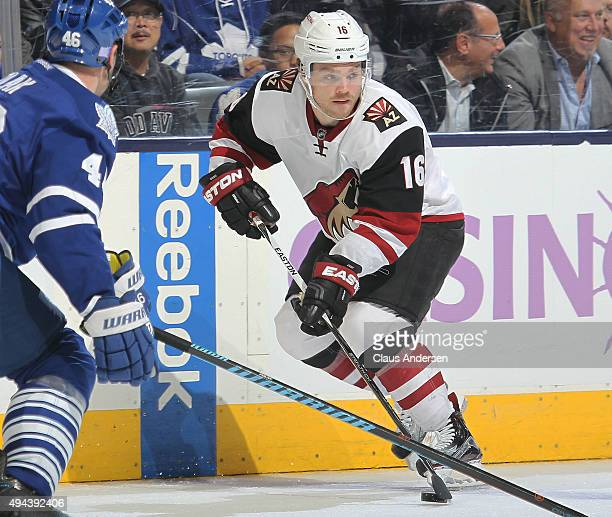 Max Domi of the Arizona Coyotes skates with the puck against the Toronto Maple Leafs during an NHL game at the Air Canada Centre on October 26 2015...