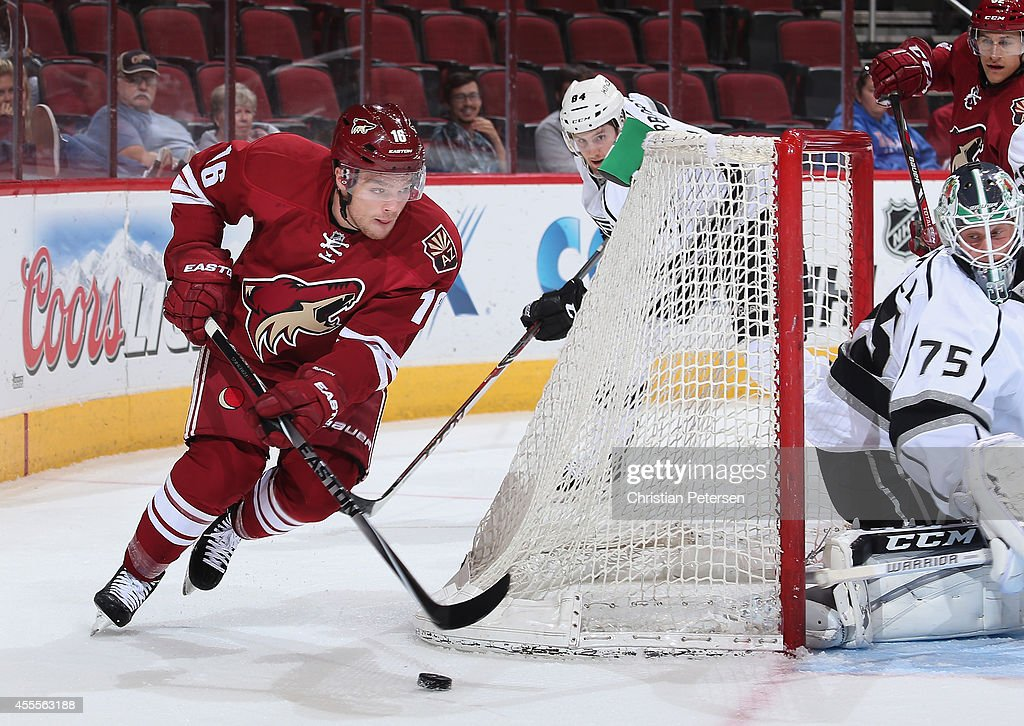 Max Domi #16 of the Arizona Coyotes skates with the puck around on goaltender Brandon Maxwell #75 of the Los Angeles Kings during the NHL rookie camp game at Gila River Arena on September 16, 2014 in Glendale, Arizona.