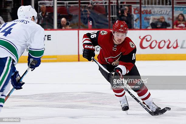Max Domi of the Arizona Coyotes skates with the puck during the NHL game against the Vancouver Canucks at Gila River Arena on October 30 2015 in...