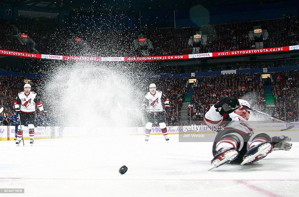 Max Domi #16 of the Arizona Coyotes slides into the boards during their NHL game against the Vancouver Canucks at Rogers Arena November 17, 2016 in Vancouver, British Columbia, Canada. Vancouver won 3-2 in overtime.
