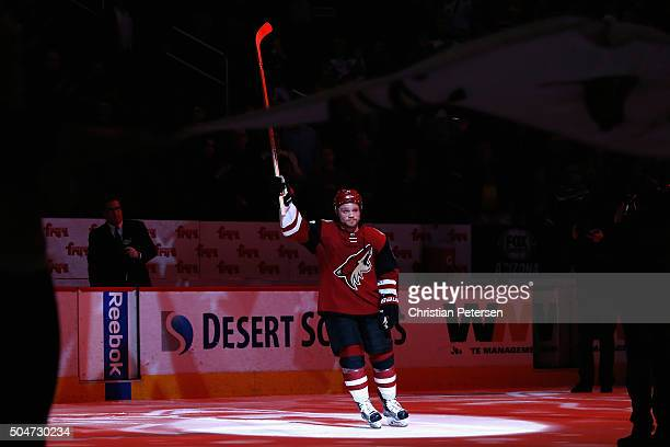 Max Domi of the Arizona Coyotes waves to fans after being named the number one star of the game following the NHL game against the Edmonton Oilers at...