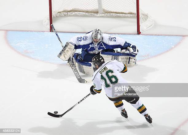 Max Domi of the London Knights breaks in for a scoring attempt on Troy Timpano of the Sudbury Wolves in an OHL game at the Budweiser Gardens on...