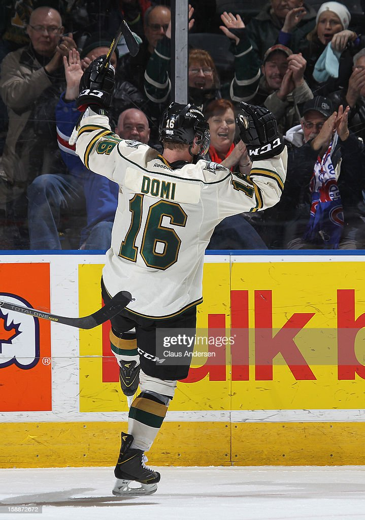 Max Domi #16 of the London Knights celebrates a goal in an OHL game against the Windsor Spitfires on December 27, 2012 at the Budweiser Gardens in London, Canada. The Knights defeated the Spitfires 9-4 to extend their winning streak to 22 games.
