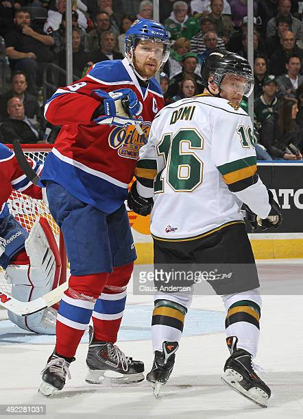 Max Domi of the London Knights is watched closely by Griffin Reinhart of the Edmonton Oil Kings in Game Three of the 2014 MasterCard Memorial Cup at...