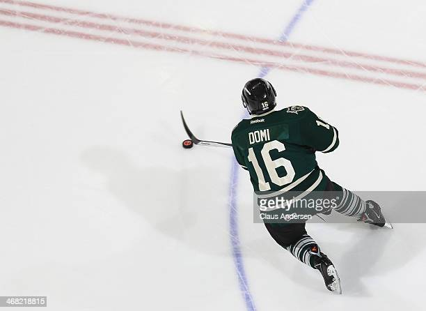 Max Domi of the London Knights skates with the puck against the Plymouth Whalers during an OHL game at the Budweiser Gardens on February 9 2014 in...