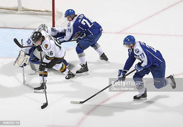 Max Domi of the London Knights tries to get a shot away at Troy Timpano of the Sudbury Wolves in an OHL game at the Budweiser Gardens on November 2...