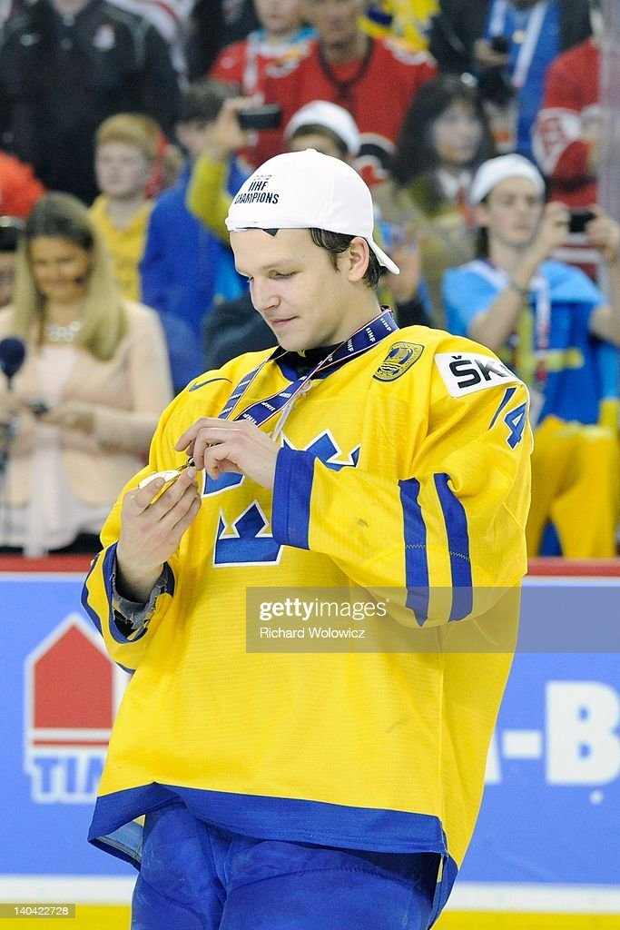 Max Frieberg #14 of Team Sweden looks at his gold medal after defeating Team Russia during the 2012 World Junior Hockey Championship Gold Medal game at the Scotiabank Saddledome on January 5, 2012 in Calgary, Alberta, Canada. Team Sweden defeated Team Russia 1-0 in overtime.