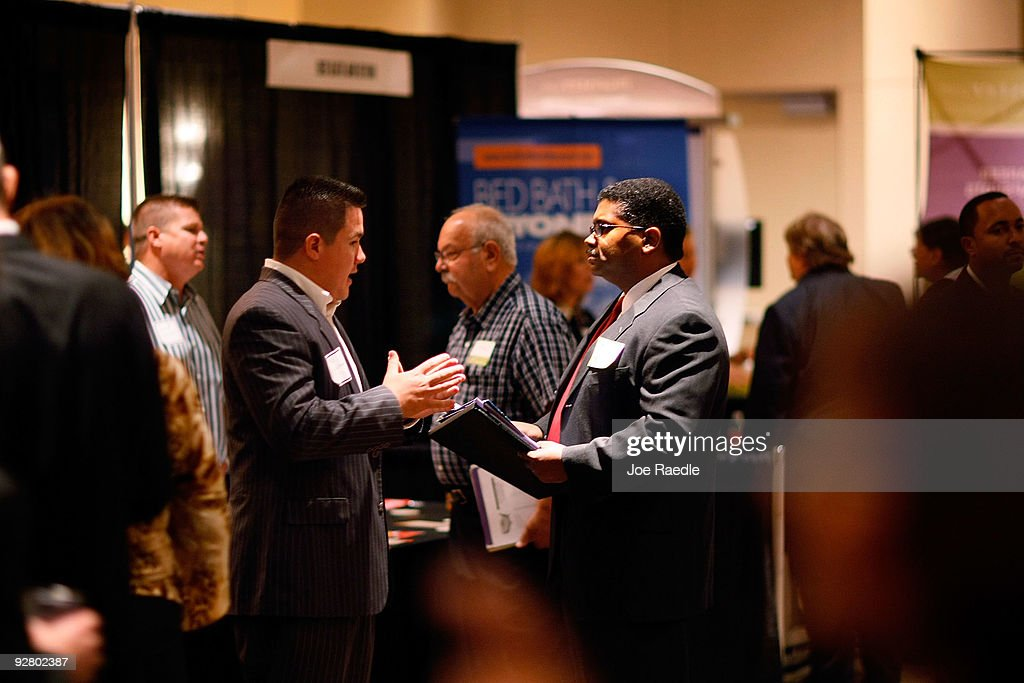 Max Ganthier, jr. (R) speaks with Mauricio Banderas as he recruits workers for United First Financial at a job fair put on by Monster.com on November 5, 2009 in Fort Lauderdale, Florida. The Monster's 'Keep America Working Tour', is helping workers find jobs as the US employment report for October, which comes out tomorrow, is expected to show that the jobless rate stayed close to a 26-year high of 9.8 per cent in September.