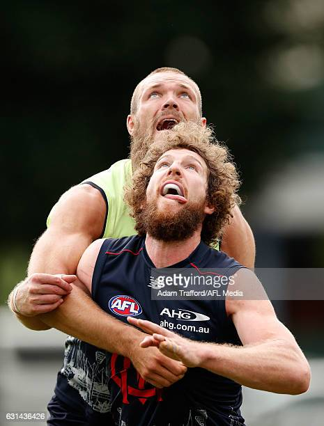 Max Gawn and Jake Spencer of the Demons compete in a ruck contest during the Melbourne Demons training session at Gosch's Paddock on January 11 2017...