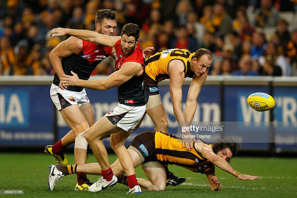 Max Gawn and James Frawley of the Demons compete against David Hale and Matt Spangher of the Hawks during the round 20 AFL match between the Hawthorn Hawks and the Melbourne Demons at Melbourne Cricket Ground on August 9, 2014 in Melbourne, Australia.