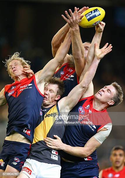 Max Gawn and Tom McDonald of the Demons of the Demons and Jack Riewoldt of the Tigers compete for the ball during the round five AFL match between...