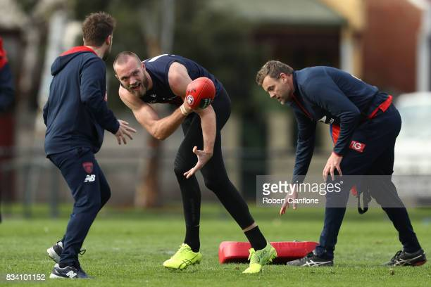 Max Gawn hand passes during a Melbourne Demons AFL training session at Gosch's Paddock on August 18 2017 in Melbourne Australia