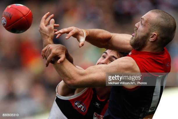 Max Gawn of the Demons and Billy Longer of the Saints compete for the ball during the 2017 AFL round 21 match between the Melbourne Demons and the St...