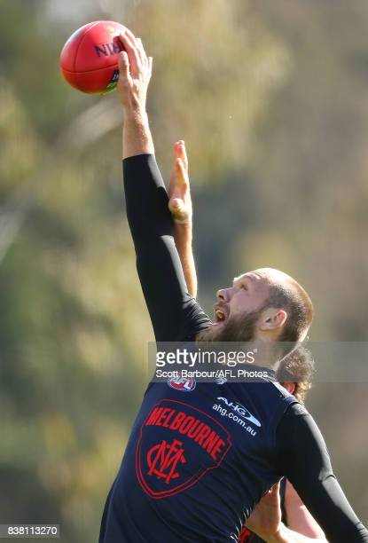 Max Gawn of the Demons and Jake Spencer of the Demons compete for the ball during a Melbourne Demons AFL training session at Gosch's Paddock on...