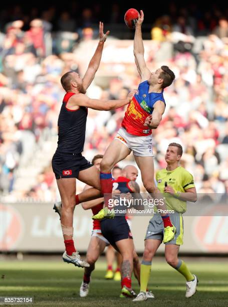 Max Gawn of the Demons and Stefan Martin of the Lions compete in a ruck contest during the 2017 AFL round 22 match between the Melbourne Demons and...