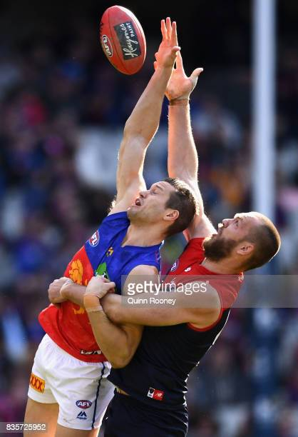Max Gawn of the Demons and Stefan Martin of the Lions compete in the ruck during the round 22 AFL match between the Melbourne Demons and the Brisbane...