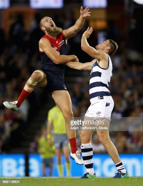 Max Gawn of the Demons and Zac Smith of the Cats compete in a ruck contest during the 2017 AFL round 03 match between the Geelong Cats and the...