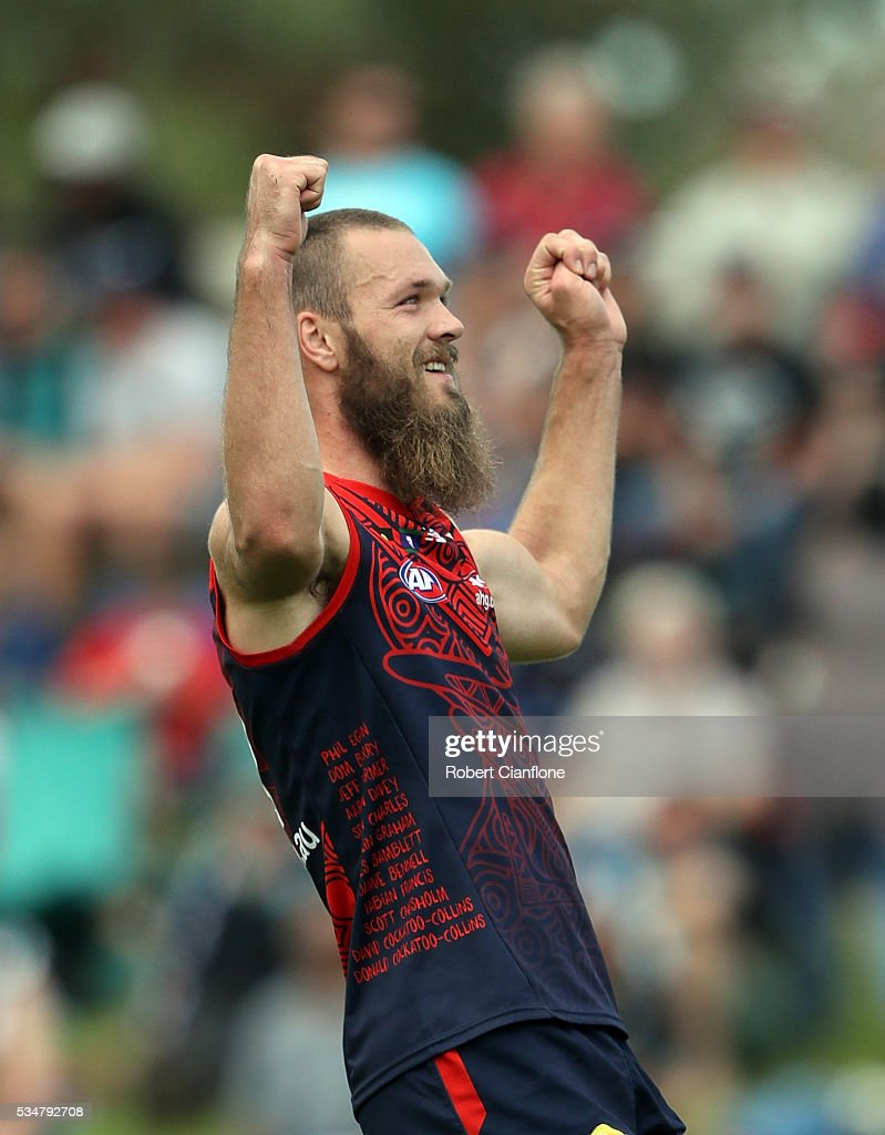 Max Gawn of the Demons celebrates after scoring a goal during the round 10 AFL match between the Melbourne Demons and the Port Adelaide Power at Traeger Park on May 28, 2016 in Alice Springs, Australia.