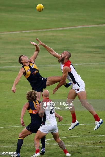 Max Gawn of the Demons contests a ruck with Drew Petrie of the Eagles during the JLT Community Series AFL match between the West Coast Eagles and the...