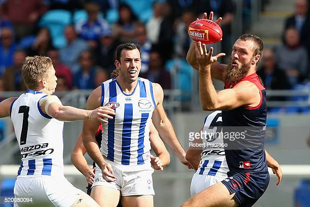 Max Gawn of the Demons gathers the ball during the round three AFL match between the North Melbourne Kangaroos and the Melbourne Demons at Blundstone...