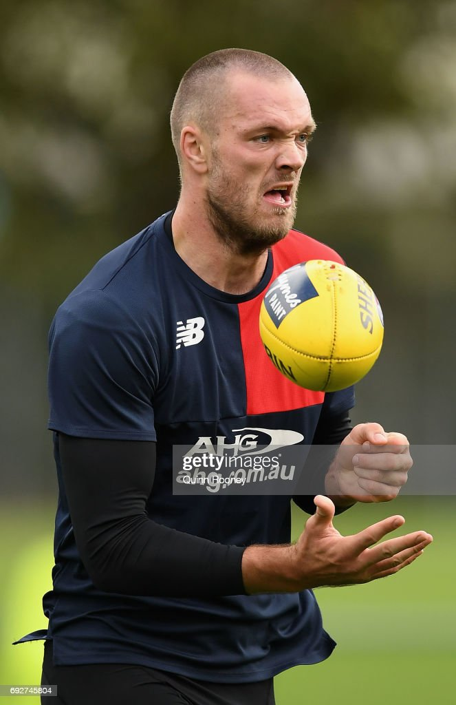 Max Gawn of the Demons handballs during a Melbourne Demons AFL training session at Gosch's Paddock on June 6, 2017 in Melbourne, Australia.