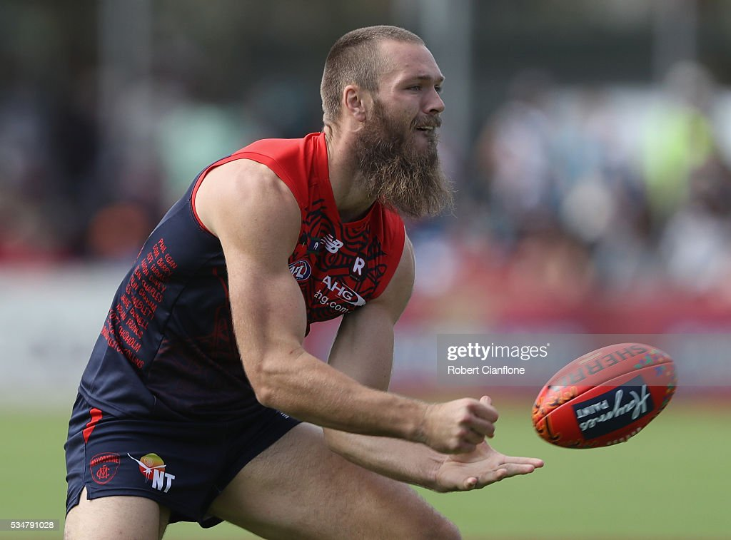 Max Gawn of the Demons handballs during the round 10 AFL match between the Melbourne Demons and the Port Adelaide Power at Traeger Park on May 28, 2016 in Alice Springs, Australia.