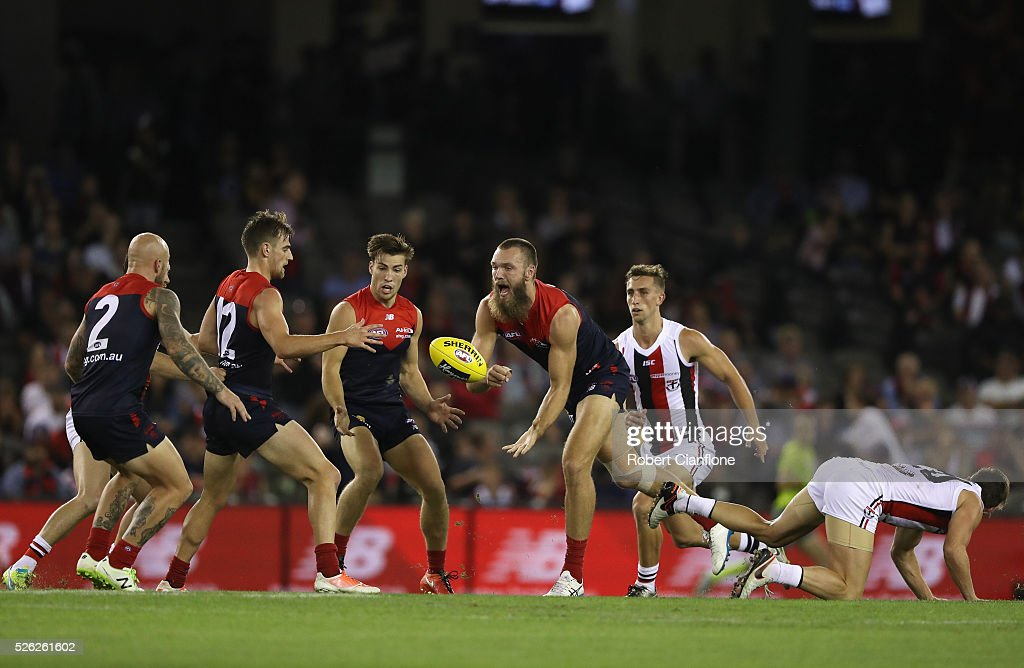 Max Gawn of the Demons handballs during the round six AFL match between the Melbourne Demons and the St Kilda Saints at Etihad Stadium on April 30, 2016 in Melbourne, Australia.