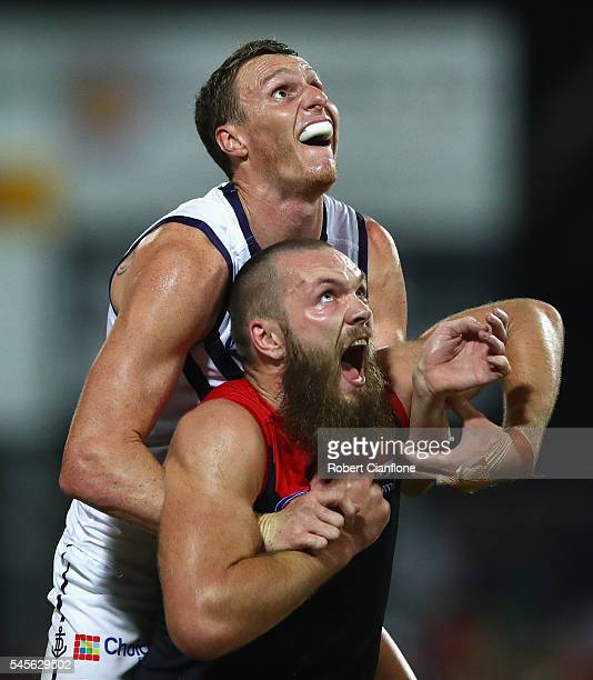 Max Gawn of the Demons is challenged by Jonathon Griffin of the Dockers during the round 16 AFL match between the Melbourne Demons and the Fremantle...