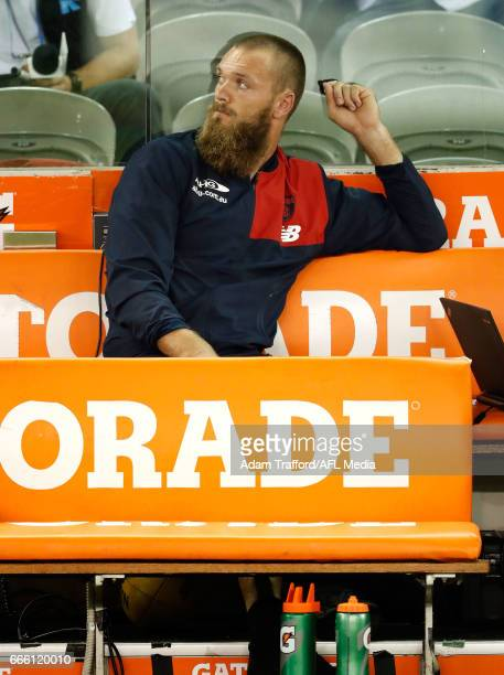 Max Gawn of the Demons is seen injured on the bench during the 2017 AFL round 03 match between the Geelong Cats and the Melbourne Demons at Etihad...