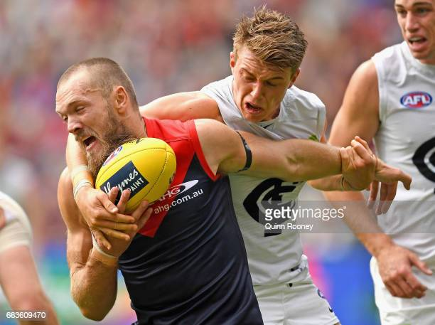 Max Gawn of the Demons is tackled by Patrick Cripps of the Blues during the round two AFL match between the Melbourne Demons and the Carlton Blues at...