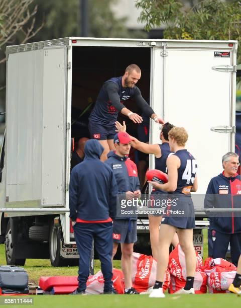 Max Gawn of the Demons jumps from the back of a truck during a Melbourne Demons AFL training session at Gosch's Paddock on August 24 2017 in...