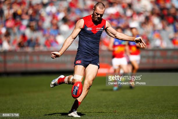 Max Gawn of the Demons kicks the ball during the round 22 AFL match between the Melbourne Demons and the Brisbane Lions at Melbourne Cricket Ground...