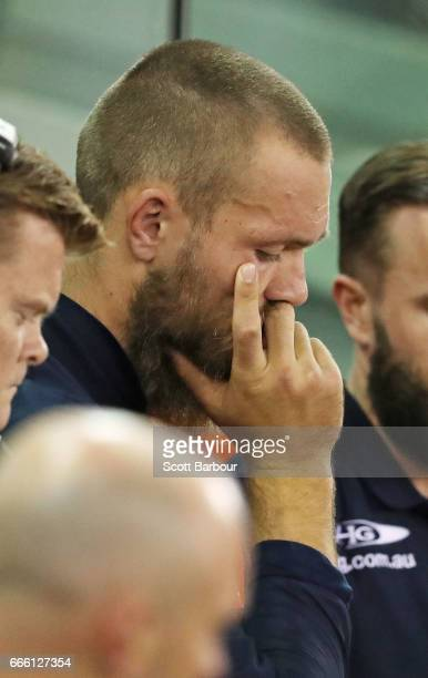 Max Gawn of the Demons looks on from the bench after leaving the field injured during the round three AFL match between the Geelong Cats and the...