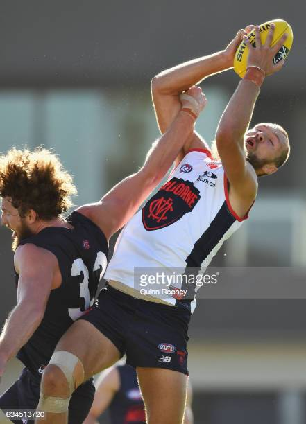 Max Gawn of the Demons marks over the top of Jake Spencer of the Demons during the Melbourne Demons AFL IntraClub match on February 10 2017 in...