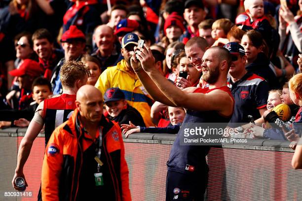 Max Gawn of the Demons poses for a selfie with fans during the round 21 AFL match between the Melbourne Demons and the St Kilda Saints at Melbourne...