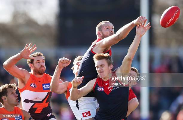 Max Gawn of the Demons punches the ball during the round 20 AFL match between the Greater Western Sydney Giants and the Melbourne Demons at UNSW...