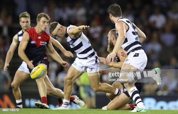 Max Gawn of the Demons tackles Joel Selwood of the Cats and injures his hamstring during the round three AFL match between the Geelong Cats and the...