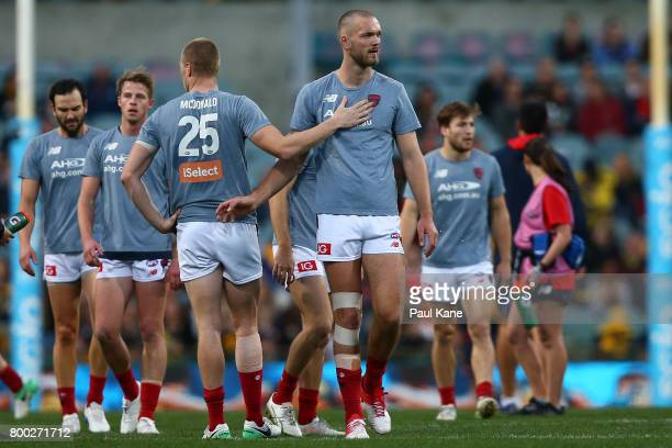Max Gawn of the Demons walks from the field after warming up during the round 14 AFL match between the West Coast Eagles and the Melbourne Demons at...