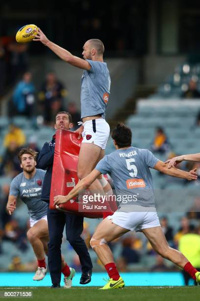 Max Gawn of the Demons warms up during the round 14 AFL match between the West Coast Eagles and the Melbourne Demons at Domain Stadium on June 24...