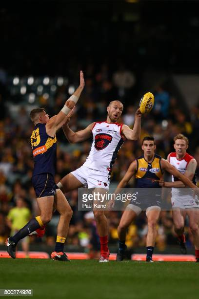 Max Gawn of the Demons wins a ruck contest against Nathan Vardy of the Eagles during the round 14 AFL match between the West Coast Eagles and the...